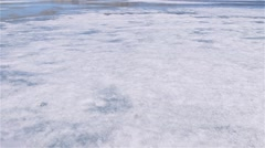 Tilt up to a landscape of Arctic Bay, Nunavut shot from the sea ice. Stock Footage