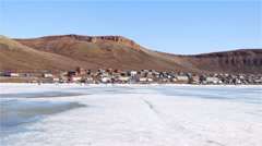 Landscape of Arctic Bay, Nunavut shot from the sea-ice. (Pan Right) Stock Footage