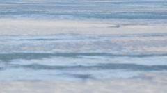 Arctic Bay, Nunavut shot from the sea ice. (Tilt Up) Stock Footage