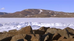 Shoreline in Arctic Bay with a lead running through the sea-ice. - stock footage