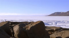 Arctic Bay shoreline with a lead running through the sea-ice. - stock footage