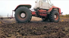 Tractor With Raised Trailer For Cultivation Driving In The Field In Ukraine Stock Footage