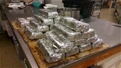 Archipelago loafs, packed in foil, at a bakery Stock Footage