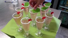 Placing mint leaves on drinks, at a restaurant Stock Footage