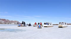 Arctic expedition team exiting camp on qamutiks. - stock footage