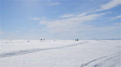 Two snowmobiles towing qamutiks in the arctic. Stock Footage