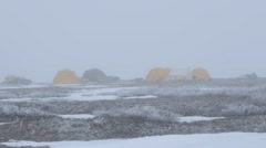 Arctic expedition team campsite veiled by fog. - stock footage
