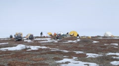 Time-lapse of an arctic expedition team tearing down their campsite. - stock footage