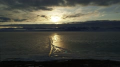 Time lapse of clouds rolling over sea ice in Arctic Bay, Nunavut. Stock Footage