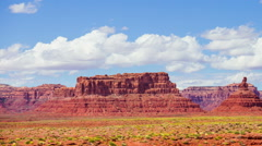 Time Lapse - Cloudscape Moving Over Buttea at Monument Valley Stock Footage