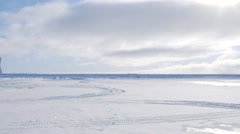 Arctic expedition camp and helicopter on frozen tundra. (Pan Left) - stock footage