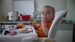 Little boy practices eating in the kitchen  8 - Without color correction - stock footage