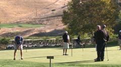Stock Video Footage of Golfers on putting green