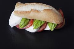 Italian mozarella tomato sandwich on slate Stock Photos