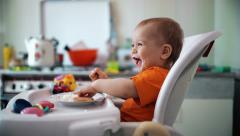 Little boy practices eating in the kitchen 9  - Color corrected - stock footage