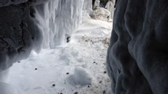 Entrance to an Arctic cave inside of a cliffside. (Tilt) Stock Footage