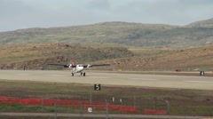 Double prop plane taking flight from an Arctic flight strip. Stock Footage