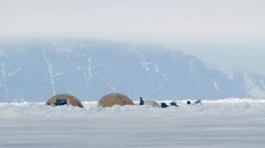 Expedition team campsite under an Arctic mountain range. - stock footage