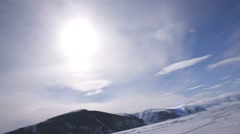 Large iceberg situated in an Arctic ice field. (Pan) Stock Footage