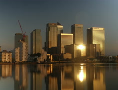 Time Lapse of London's Canary Wharf Towers at Sunrise Stock Footage