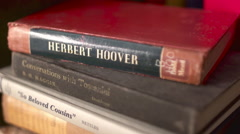 Pan Across Stack of Old Books Stock Footage