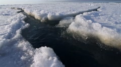 Cracks in Arctic sea ice floating and shifting with the ocean currents. (Dolly) - stock footage