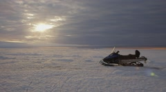Ski-doo parked in the seemingly endless Arctic landscape. Stock Footage