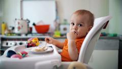 Little boy practices eating in the kitchen 7  - Color corrected Stock Footage