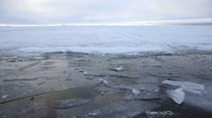 A deep ice lead cutting through frozen Arctic sea. - stock footage