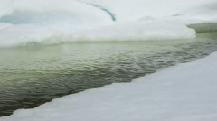 A deep lead cutting through Arctic sea ice. - stock footage