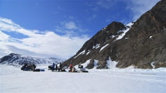 Time lapse of an Arctic expedition team setting up base camp. - stock footage