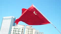Five star red flag, flying in the sky Stock Footage