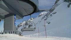 Skiers and snowboarders getting off a Whistler chairlift. Stock Footage