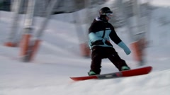 A snowboarder going off of a jump in Whistler. Stock Footage