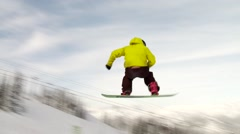 BC, Whistler, Snowboarder doing a           off a jump - stock footage
