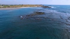 Aerial surveillance of the azure sea slick. - stock footage