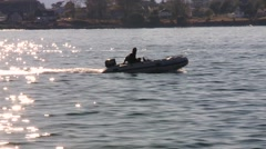 A man in a small inflatable boat off the coast of Victoria, British Columbia. - stock footage