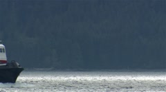 Tug Boat crossing a British Columbian cove. Stock Footage
