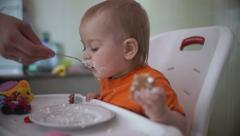 Little boy practices eating in the kitchen 21  - Without color correction Stock Footage