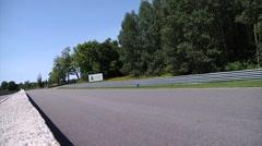 A black Porsche takes two corners at Calabogie Raceway. Stock Footage