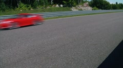 Four cars race by in pack at Calabogie Raceway. Stock Footage