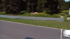 Stock Video Footage of Calabogie, Raceway, White Porsche Heading Down the Straightaway