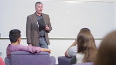A professor speaks to his class Stock Footage