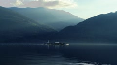 Cargo ship floating down Johnstone Strait, British Columbia. Stock Footage