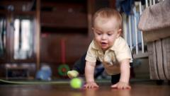 Little boy child play with the ball on the floor  - Color corrected Stock Footage