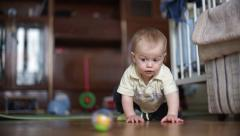 Stock Video Footage of Little boy child play with the ball on the floor  - Without color correction