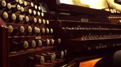 A woman plays a church organ. Arkistovideo