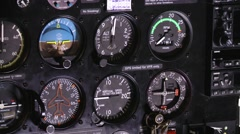 Dials and gauges in cockpit show flight data. - stock footage