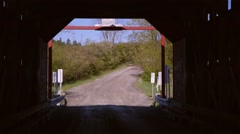 Exit to a covered bridge shot from inside. - stock footage