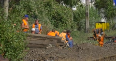 Workers Men in Orange Workwear Have a Rest Smoking Sitting Talking Break Stock Footage
